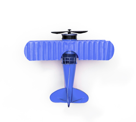Foto de blue Metal toy plane isolated on white - Imagen libre de derechos