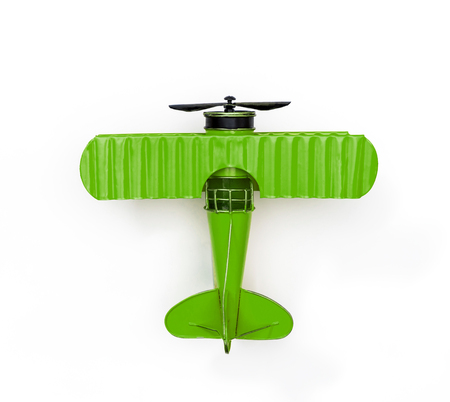 Foto de green Metal toy plane isolated on white - Imagen libre de derechos