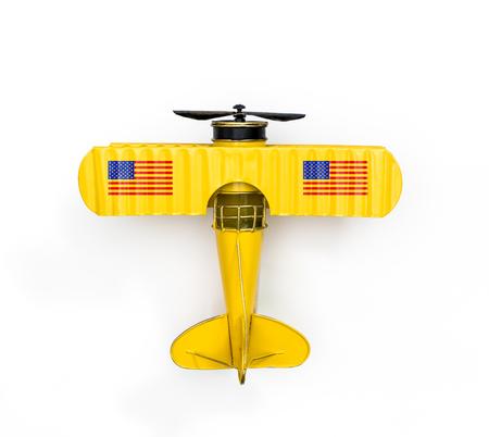 Foto de National Flag of America Metal toy plane isolated on white - Imagen libre de derechos