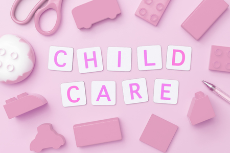Foto de Children care concept text on pink toy object background - Imagen libre de derechos