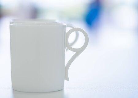 Foto de White Ceramic coffee tea cup on office table - Imagen libre de derechos
