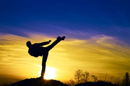 Photo for Man karate in the sunset. - Royalty Free Image