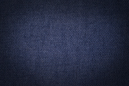 Background texture of a blue painted canvas.
