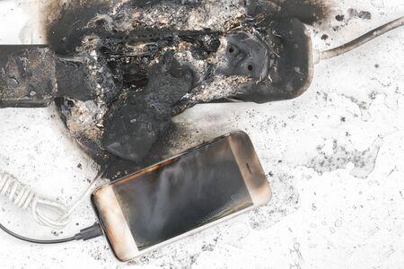 Foto de the burned-down power supply, phone, possible cause of the fire - Imagen libre de derechos
