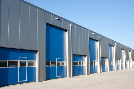 Photo for Industrial Unit with roller shutter doors - Royalty Free Image