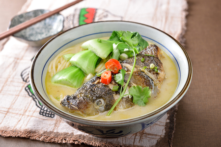 Photo for Fish head noodle in a ceramic bowl - Royalty Free Image