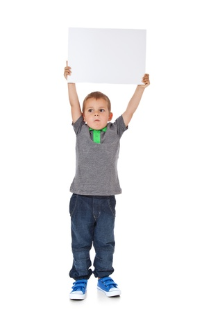 Full length shot of a cute little boy holding a blank white sign  All isolated on white background