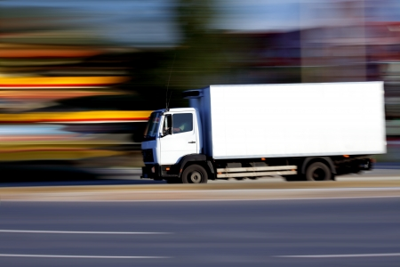 Foto de White truck on  road  on abstract blur background  - Imagen libre de derechos