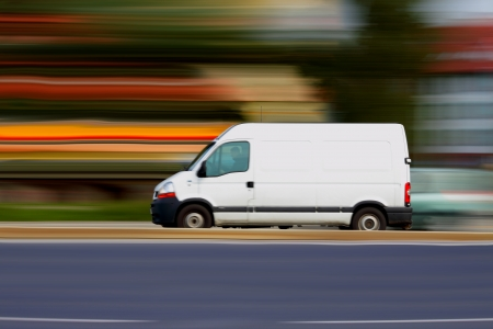Foto de Blur speedy  white van with white blank for your text - Imagen libre de derechos