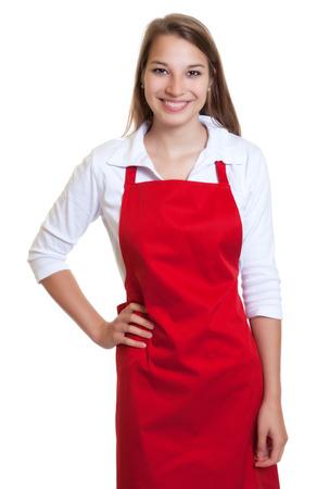 Foto de Laughing waitress with red apron - Imagen libre de derechos