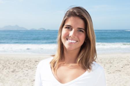 Beautiful blonde woman at beach