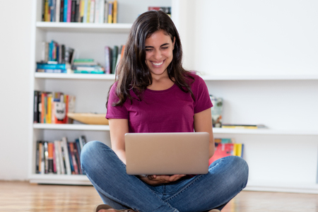 Photo pour Happy indian woman shopping online with computer indoor at home - image libre de droit