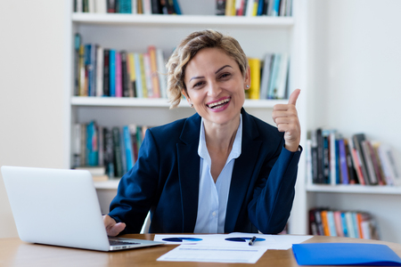 Photo for Successful mature businesswoman working on computer - Royalty Free Image