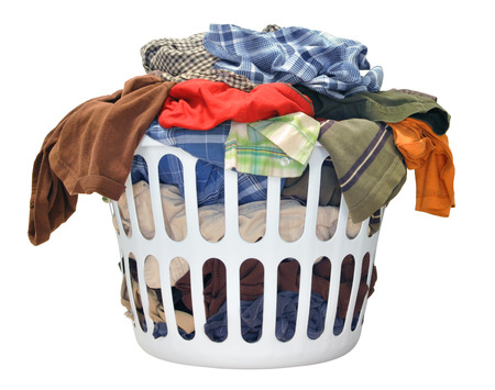 Photo pour Pile of dirty laundry in a washing basket on a white background - image libre de droit