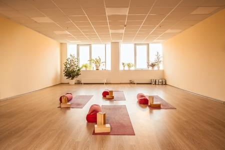 Photo for empty bright yoga room with mats and requisite. - Royalty Free Image