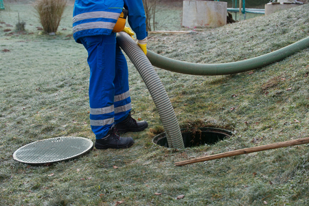 Photo pour Emptying household septic tank. Cleaning sludge from septic system. - image libre de droit