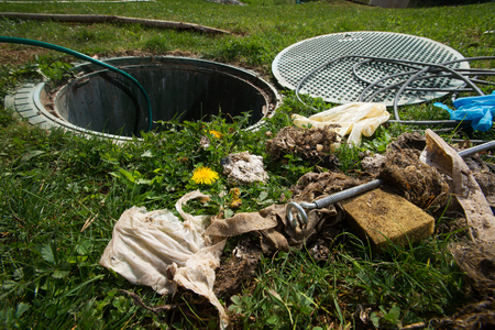 Photo pour Unclogging septic system. Cleaning and unblocking drain full of disposable wipes and other non biodegradable items. - image libre de droit
