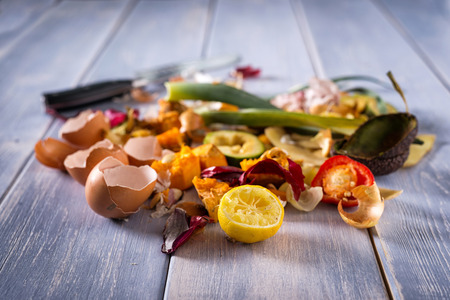 Photo for Organic leftovers, kitchem scraps, waste from vegetable ready for recycling and to compost. Collecting food leftovers for composting. Environmentally responsible behavior, ecology concept. Copy space. - Royalty Free Image