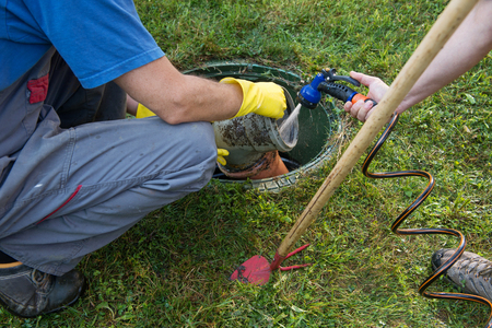 Photo pour Cleaning and unblocking septic system and draining pipes. - image libre de droit