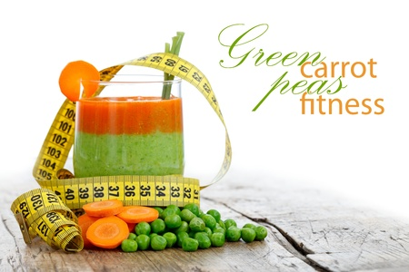 Fresh carrot and pea smoothie with measure tape, diet concept with place for your text on the right