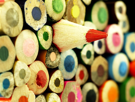 Photo for Wooden crayons. Different than other.  Multicolored surface. - Royalty Free Image