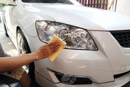 Hand with a wipe the car polishing, car wash