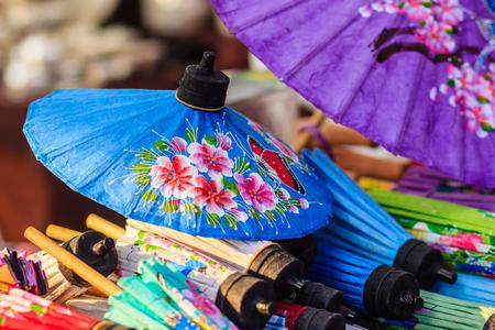 Foto de Beautiful handmade umbrellas for sale in the local market at northern Thailand. - Imagen libre de derechos