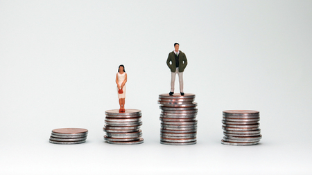 Photo for Four piles of coins and miniature people. The concept of wage disparity between men and women. - Royalty Free Image