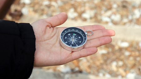 Photo for A compass on the palm of one's hand. - Royalty Free Image