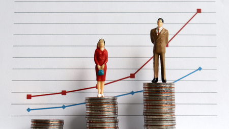Photo for Miniature people standing on a pile of coins in front of a graph. The concept of the growing income gap in the profession. - Royalty Free Image