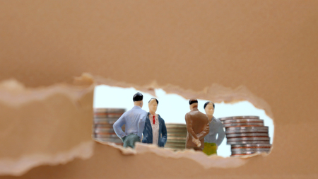 Photo for Torn paper and miniature people. The concept of working men. - Royalty Free Image
