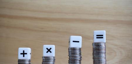 Photo pour The four arithmetic symbol cubes on top of the four coins. - image libre de droit