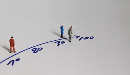 Foto de Miniature people and the concept of an aging society. - Imagen libre de derechos