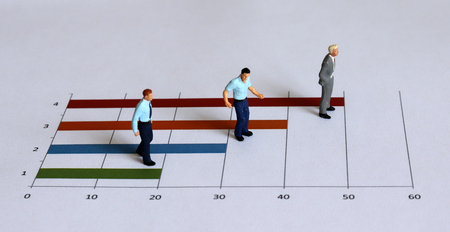 Photo for Miniature people standing on the bar graph. - Royalty Free Image