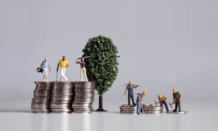 Photo for Miniature people standing on a pile of coins. Concepts about the lives of the rich and the poor. - Royalty Free Image