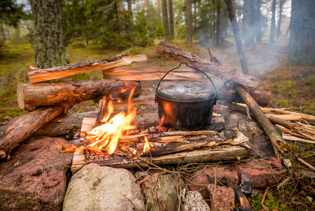 Photo for Pot kettle on a campfire in the forest - Royalty Free Image