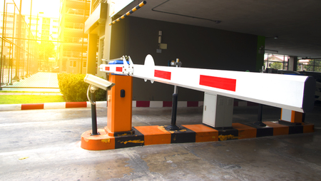 Foto de Security system for building access - barrier gate stop with toll booth, traffic cones and cctv - Imagen libre de derechos