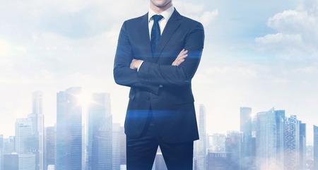 Photo pour Businessman and blurred city on horizon - image libre de droit