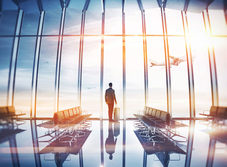 Photo for Businessman at airport with suitcase - Royalty Free Image