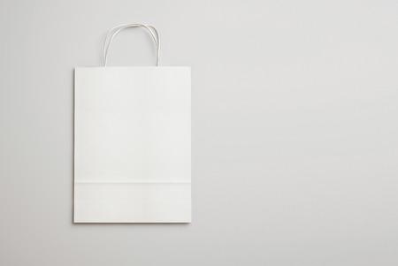 Photo pour Blank paper bag with handles. 3D rendering - image libre de droit
