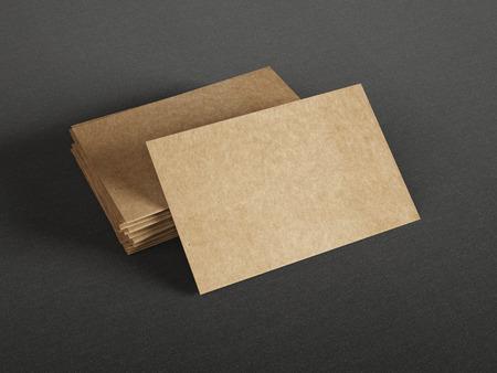 Photo pour Cardboard business cards on dark background - image libre de droit