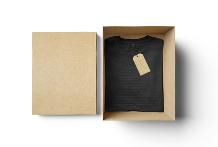 Foto de Empty rectangle shape box made of cardboard and black tshirt with label - Imagen libre de derechos