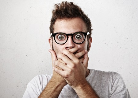 Photo for Portrait of a surprised young man wearing eyeglasses - Royalty Free Image