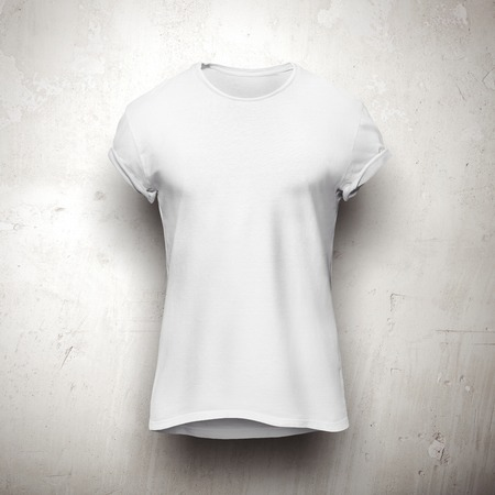 Foto de White t-shirt isolated on the grey wall - Imagen libre de derechos