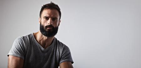 Photo pour Close-up portrait of a handsome bearded man - image libre de droit