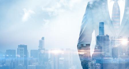 Foto de Double exposure of businessman wearing the suit in the modern city on the sunrise. - Imagen libre de derechos