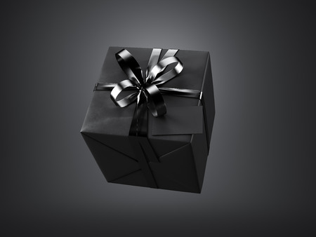 Foto de Black gift box with black ribbon bow and blank business card, isolated on black background. - Imagen libre de derechos