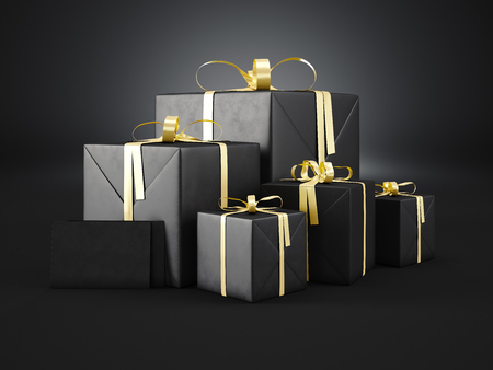 Photo for Set of black gift boxes of various sizes with golden ribbon bow and two blank envelope  on dark background. - Royalty Free Image