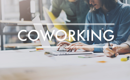 Foto de Team succes, coworking world. Photo young business managers  working with new startup project in modern loft. Analyze plans. Contemporary notebook  wood table, typing laptop, papers, documents. - Imagen libre de derechos