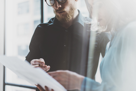 Photo pour Business team work process modern office.Photo professional crew working with new startup project. Project managers meeting. Analyze  plans.Coworking world. Blurred background, film effect. - image libre de droit